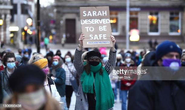 """Lady holds sign saying """"Sarah deserved to be safe"""" during a vigil for Sarah Everard, following her kidnap and murder,on March 13, 2021 in Nottingham,..."""
