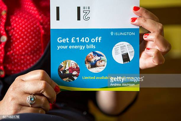 A lady holds up an Islington council energy bill offer leaflet SHINE part of Islington council is a onestop referral system for children and...