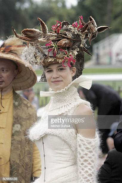 A lady in a flamboyant hat attends the Prix de Diane Hermes on June 13 2004 in Chantilly France
