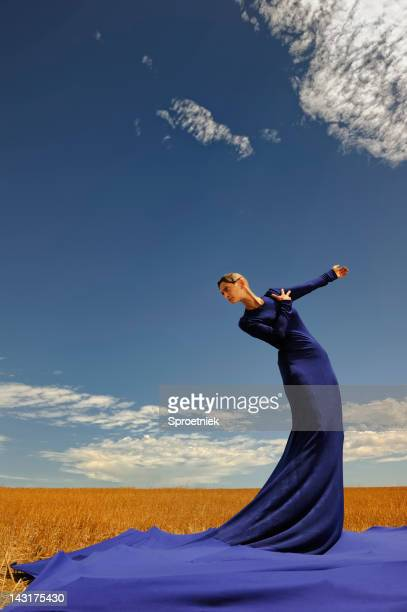 lady in blue dress against sky portrait - haute couture stock pictures, royalty-free photos & images