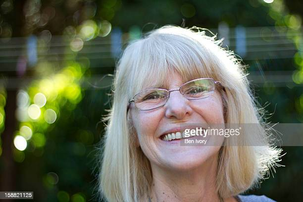 Lady in garden smiling at camera