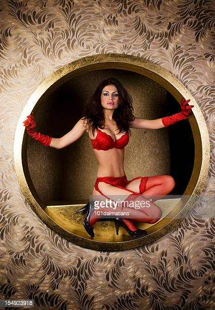 lady in red - suspenders stock pictures, royalty-free photos & images