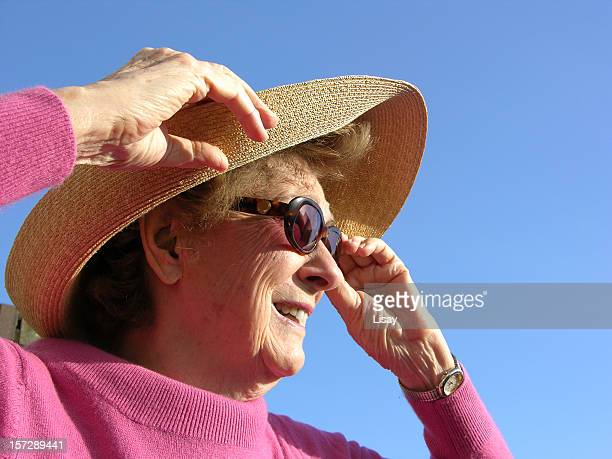 Lady in Sunhat and Sunglasses