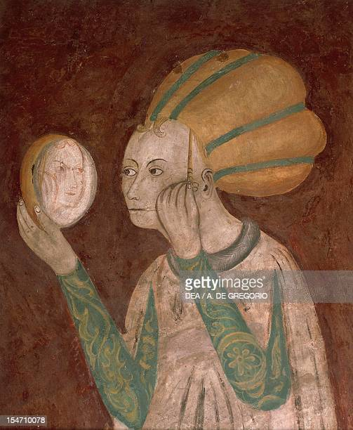 Lady in the mirror detail of a 15th century fresco Hall of Vices and Virtues Castiglioni Mantegazza castle Masnago village Varese Italy 15th century