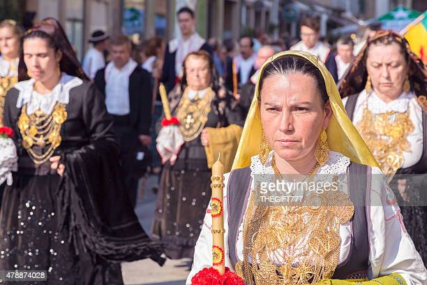 Lady in traditional costume at a procession in Braga