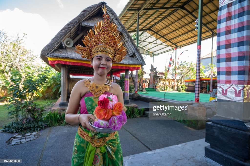 Lady in traditional costume pose for camera before perform a Barongan dance. : Stock Photo