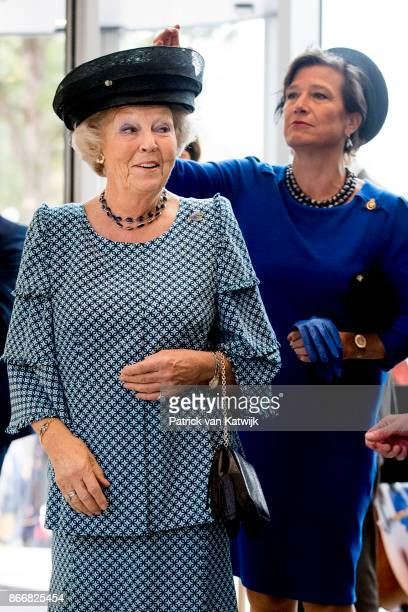Lady in Waiting Annemijn Crince Le Roy van Munster Heuven removes confetti from the hat of Princess Beatrix of The Netherlands opens the cultural...
