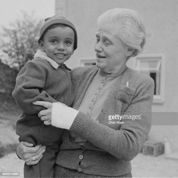 Lady Isobel Cripps widow of statesman Sir Stafford Cripps with her grandson Kwame Anthony Appiah outside her new home in Minchinhampton in the...
