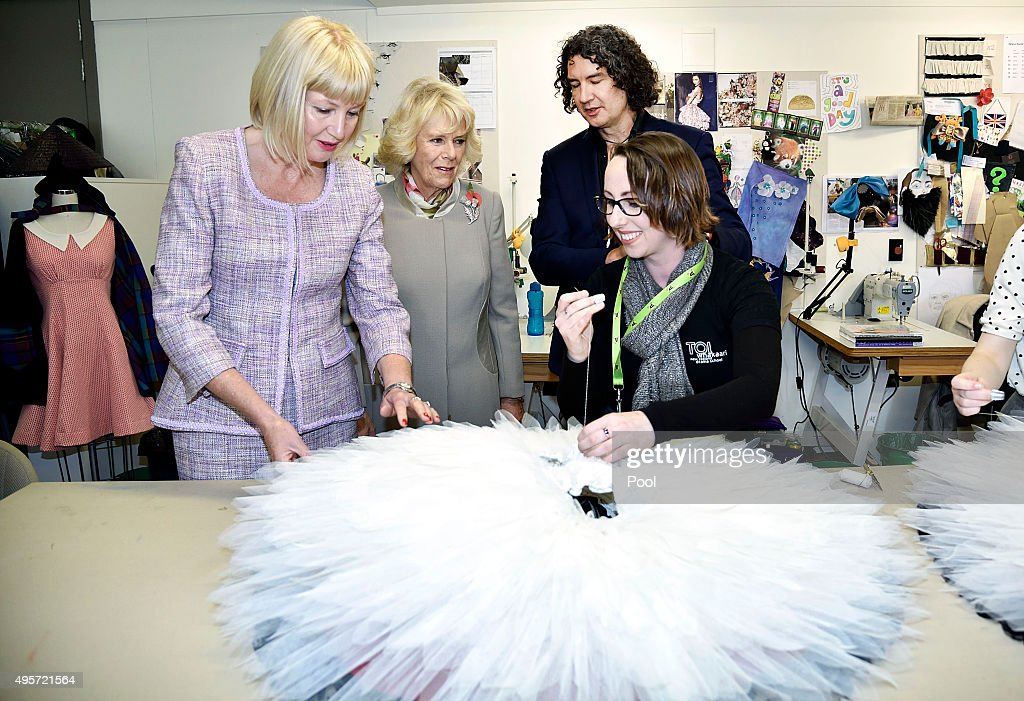 Lady Janine Mateparae, Camilla, Duchess of Cornwall and director of Toi Whakaari Christian Penny speak with a student sewing a costume during a visit to the Te Whaea National Dance Centre on November 5, 2015 in Wellington, New Zealand. The Royal couple are on a 12-day tour visiting seven regions in New Zealand and three states and one territory in Australia.