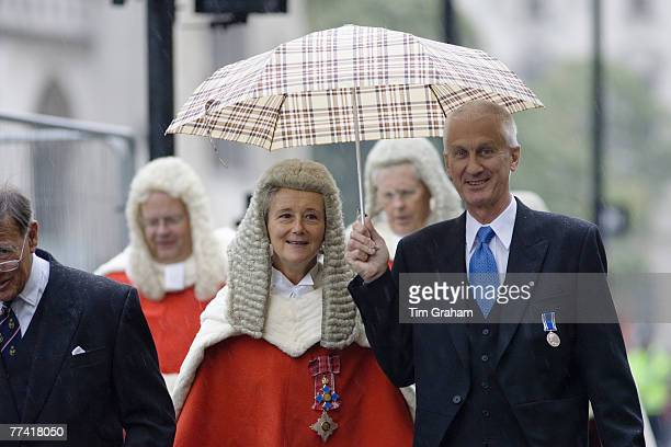 Lady judge sheltered from rain in Judges Procession from Westminster Abbey London England United Kingdom