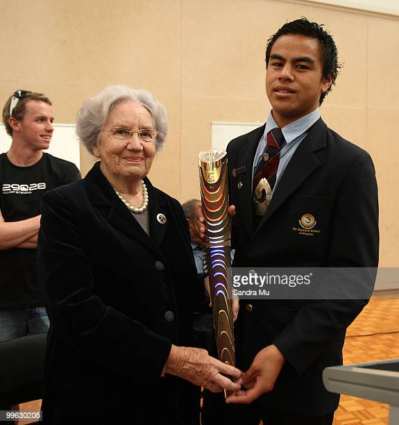 Lady June Hillary hands over the Queen's Baton to head boy ArthurTuiafiso as part of the Delhi 2010 Commonwealth Games Queen's Baton relay at Sir...