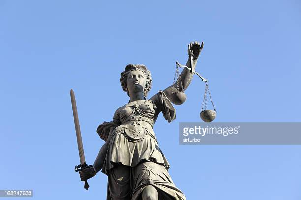 lady justice against blue sky - juror law stock pictures, royalty-free photos & images