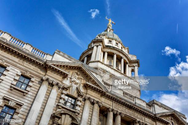 lady justice on top of old bailey the central criminal court of england and wales in london - justice concept stock pictures, royalty-free photos & images
