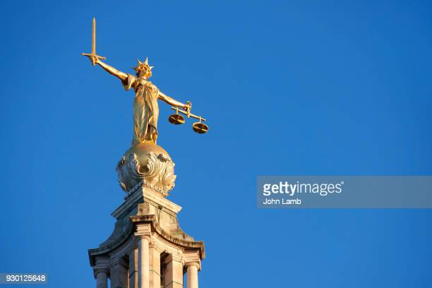 lady justice on top of the central criminal courts. - old bailey stock photos and pictures