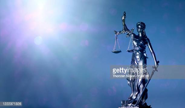 lady justice or justitia holding balance scales - panoamic image wih copy space. - justice concept stock pictures, royalty-free photos & images
