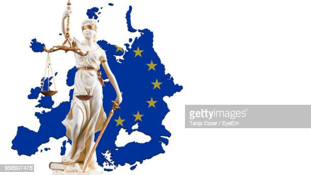 Lady Justice With European Union Flag Against White Background