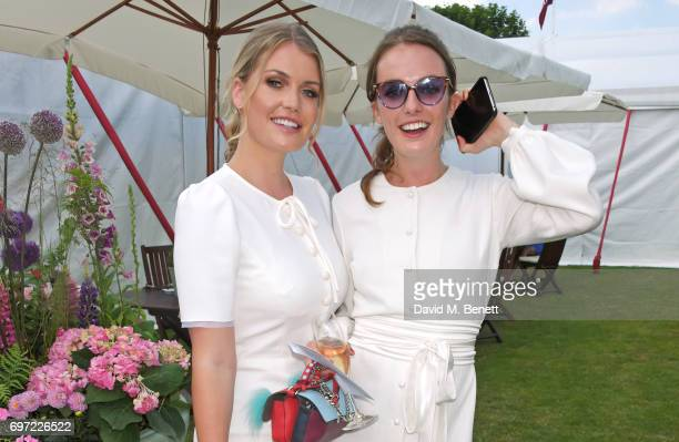 Lady Kitty Spencer and Lady Violet Manners attend the Cartier Queen's Cup Polo final at Guards Polo Club on June 18 2017 in Egham England