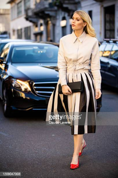 Lady Kitty Spencer, wearing a cream leather shirt, cream and black midi skirt, red heels and black bag, is seen outside Tod's show, during Milan...