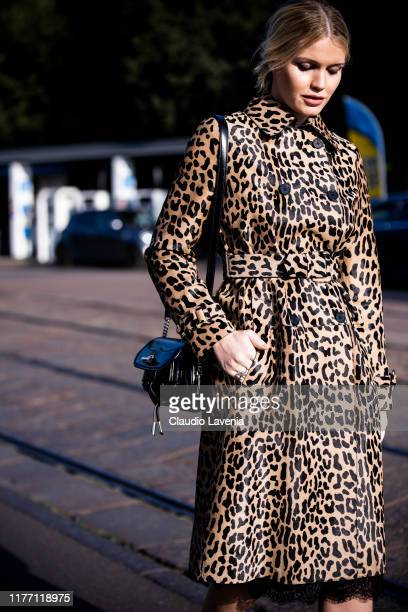 Lady Kitty Spencer, wearing a leopard print trench coat and black Tod's bag, is seen outside the Tod's show during Milan Fashion Week Spring/Summer...