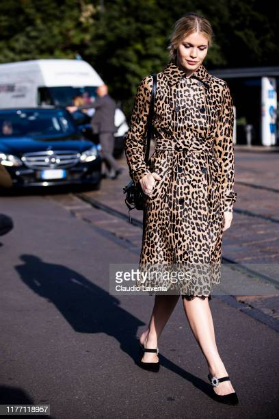 Lady Kitty Spencer, wearing a leopard print trench coat, black heels and black Tod's bag, is seen outside the Tod's show during Milan Fashion Week...