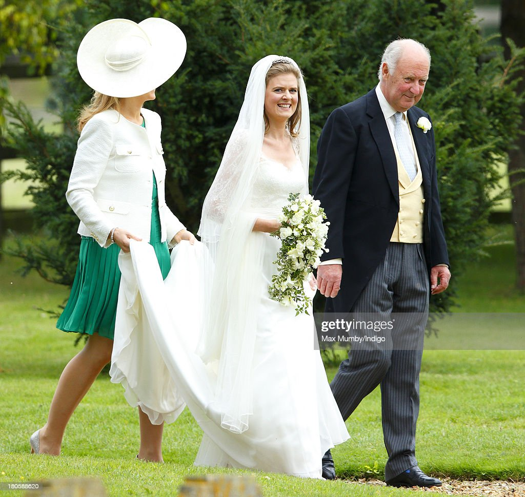 Lady Laura Marsham accompanied by her father Julian Marsham, Earl of Romney arrives for her wedding to James Meade at the Parish Church of St. Nicholas in Gayton on September 14, 2013 near King's Lynn, England.