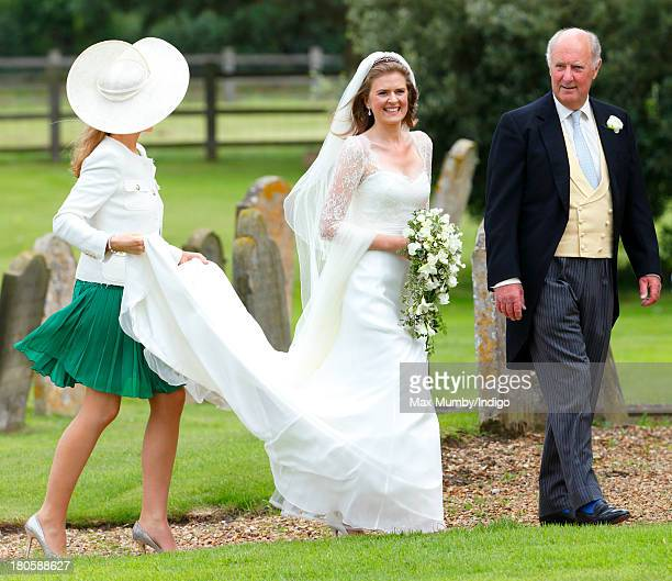 Lady Laura Marsham accompanied by her father Julian Marsham Earl of Romney arrives for her wedding to James Meade at the Parish Church of St Nicholas...