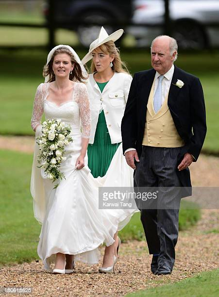 Lady Laura Marsham accompanied by her father Julian Marsham Earl of Romney arrives for the wedding of James Meade and Lady Laura Marsham at The...