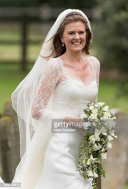 Lady Laura Marsham attends the wedding of James Meade and Lady Laura Marsham at The Parish Church of St Nicholas in Gayton on September 14 2013 in...