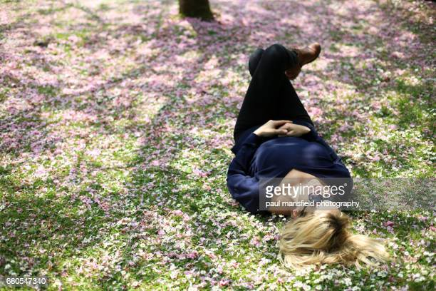 Lady laying down among blossom
