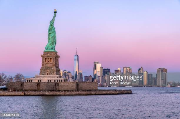 lady liberty and skyline of new york, usa - statue of liberty stock pictures, royalty-free photos & images