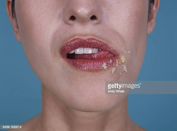 Lady Licking Crumbs from Lips