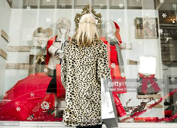lady looking at a shop window during Christmas tim