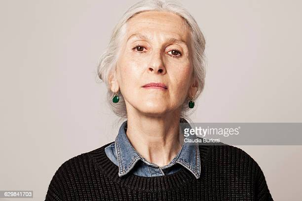 lady looking young - serious stock pictures, royalty-free photos & images