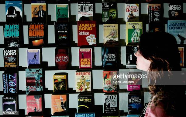 A lady looks at a collection of Ian Fleming James Bond 007 books at the 'For Your Eyes Only Ian Fleming James Bond Press View' at the Imperial War...
