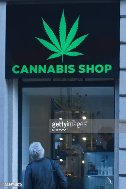A lady looks by the Dr Ziolko Cannabis Shop window a new shop opened in Krakow's city center On Wednesday November 6 in Krakow Poland