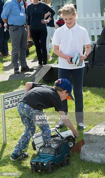 Lady Louise Windsor and James Viscount Severn play on the remote control Land Rover stand at the Royal Windsor Horse Show at Home Park on May 14 2014...