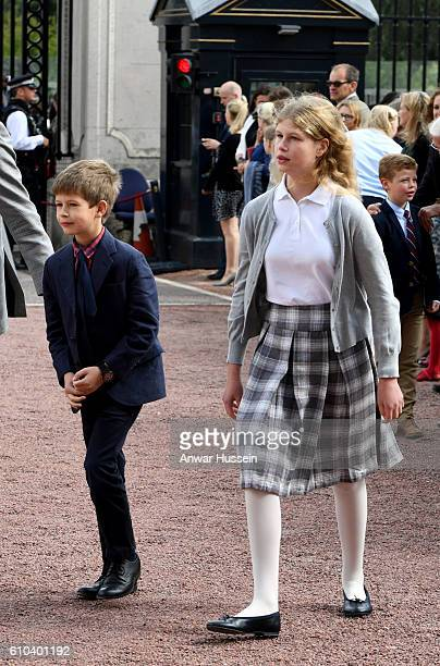 Lady Louise Windsor and James Viscount Severn wait for their mother Sophie Countess of Wessex to arrive in the forecourt of Buckingham Palace to...