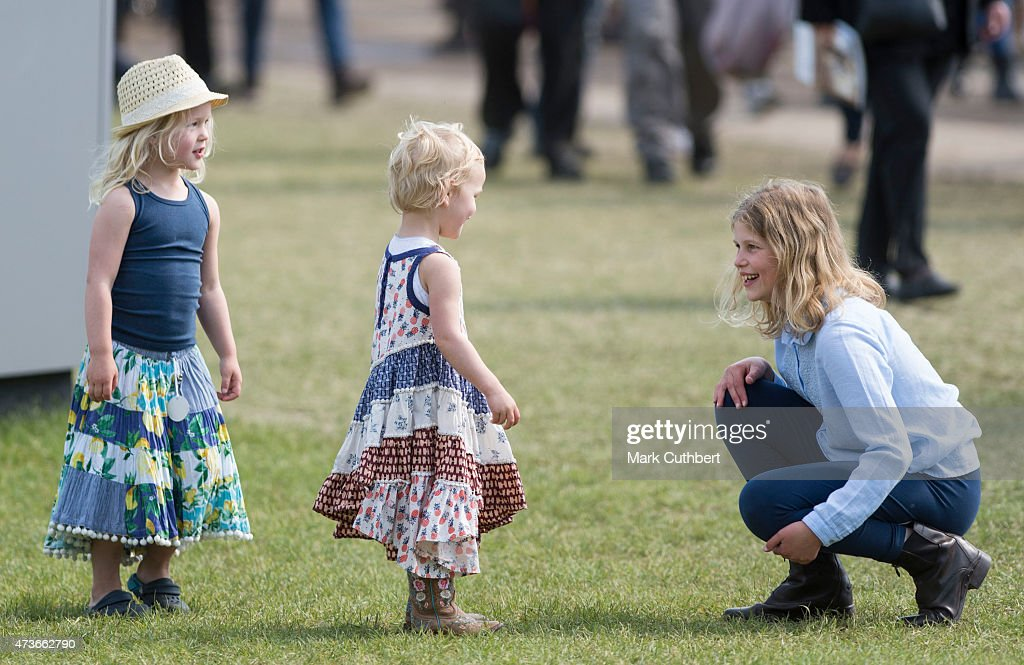 Lady Louise Windsor plays with Isla Phillips and Savannah Phillips at the Royal Windsor Horse show in the private grounds of Windsor Castle on May 16, 2015 in Windsor, England.