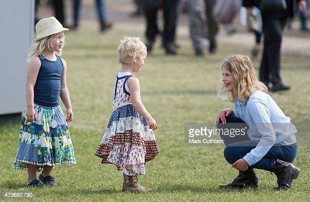 Lady Louise Windsor plays with Isla Phillips and Savannah Phillips at the Royal Windsor Horse show in the private grounds of Windsor Castle on May 16...