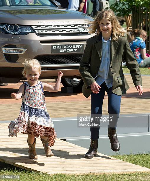 Lady Louise Windsor plays with Isla Phillips at the Royal Windsor Horse show in the private grounds of Windsor Castle on May 16, 2015 in Windsor,...