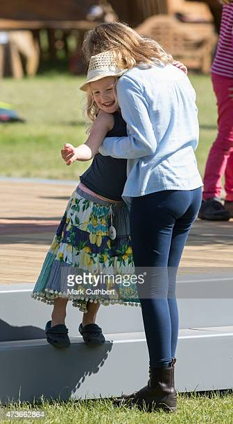 Lady Louise Windsor plays with Savannah Phillips at the Royal Windsor Horse show in the private grounds of Windsor Castle on May 16 2015 in Windsor...