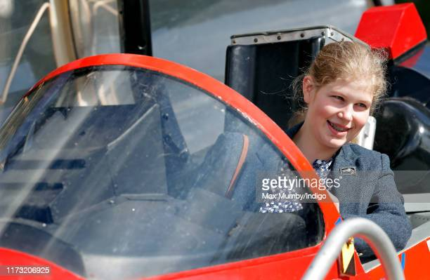 Lady Louise Windsor sits in the cockpit of a Red Arrows Hawk Jet as she attends The Land Rover Burghley Horse Trials at Burghley House on September 8...