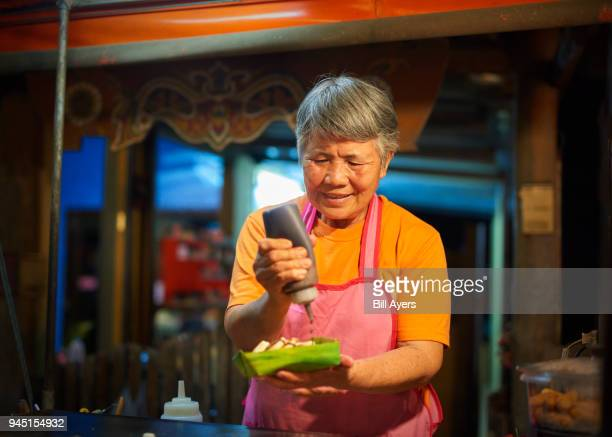 A lady makes and sells pancakes to order