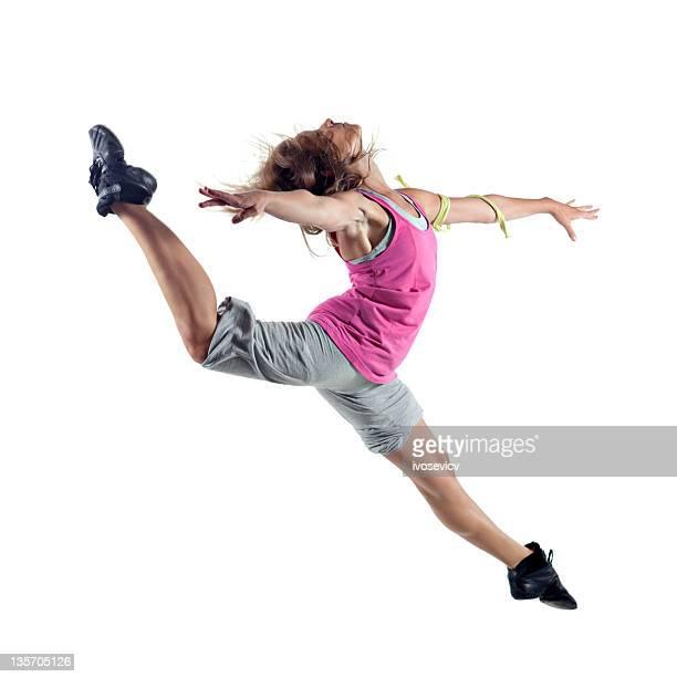 Lady modern ballet dancer caught mid air during jump