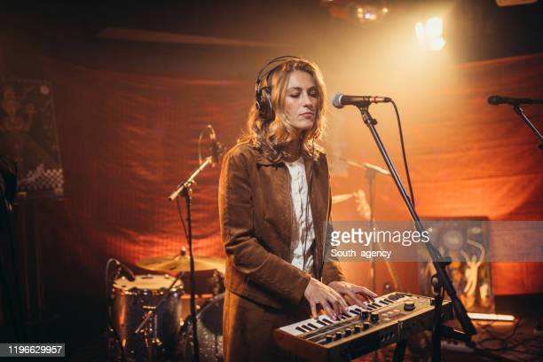 lady musician playing keyboard - keyboard player stock pictures, royalty-free photos & images