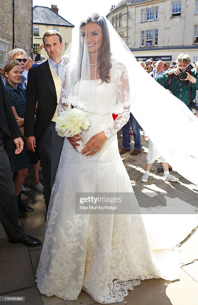 Lady Natasha Rufus Isaacs arrives at the church of St John the Baptist for her and Rupert Finch's wedding on June 8, 2013 in Cirencester, England.
