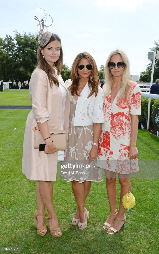 Lady Natasha Rufus Isaacs, Katy Wickremesinghe and Martha Ward pose in the winners enclosure after the Pioneering Women's Luncheon at Glorious Goodwood Ladies Day at Goodwood on July 31, 2014 in Chichester, England.
