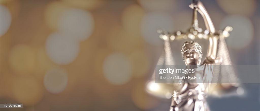 Lady Of Justice Against Illuminated Lights : Stock Photo