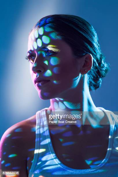 lady of layered with different patterns of blue light and shadows on her face and shoulder - beautiful israeli women stock pictures, royalty-free photos & images