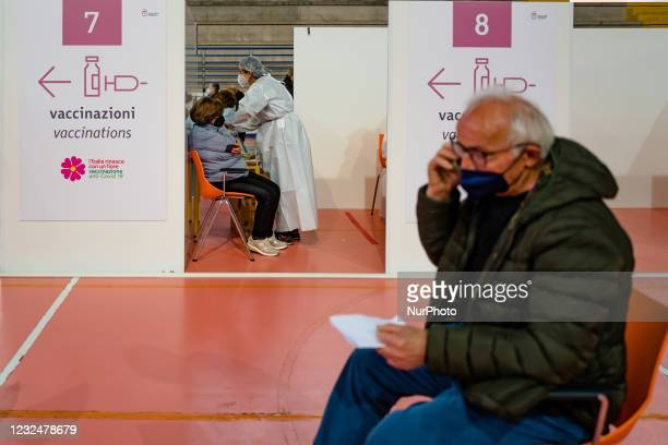 Lady over 70 during the vaccination, on the first day of opening of the Palachicoli in Terlizzi on 23 April 2021. The PalaChicoli Population...